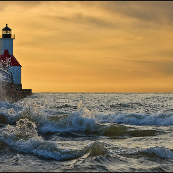 <p>Waves splash against the St. Joseph, Michigan lighthouse Pier on a mild but windy April evening.</p>