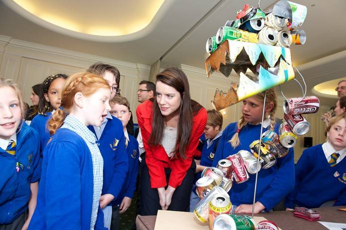 Actress Michelle Ryan with children from English Martyrs, and 'Mizuchi' their Japanese river serpent made from recycled